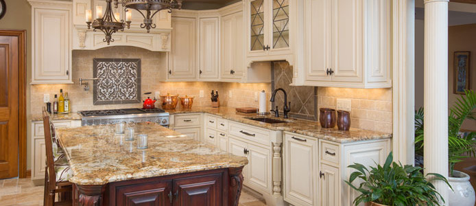 Grabill kitchen cabinets with LeMitre door style and perimeter cabinets, made from maple wood with a painted finish in Travatine Glaze